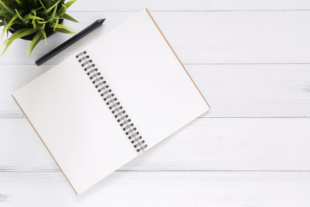 Notebook on a table - checklist for house viewings